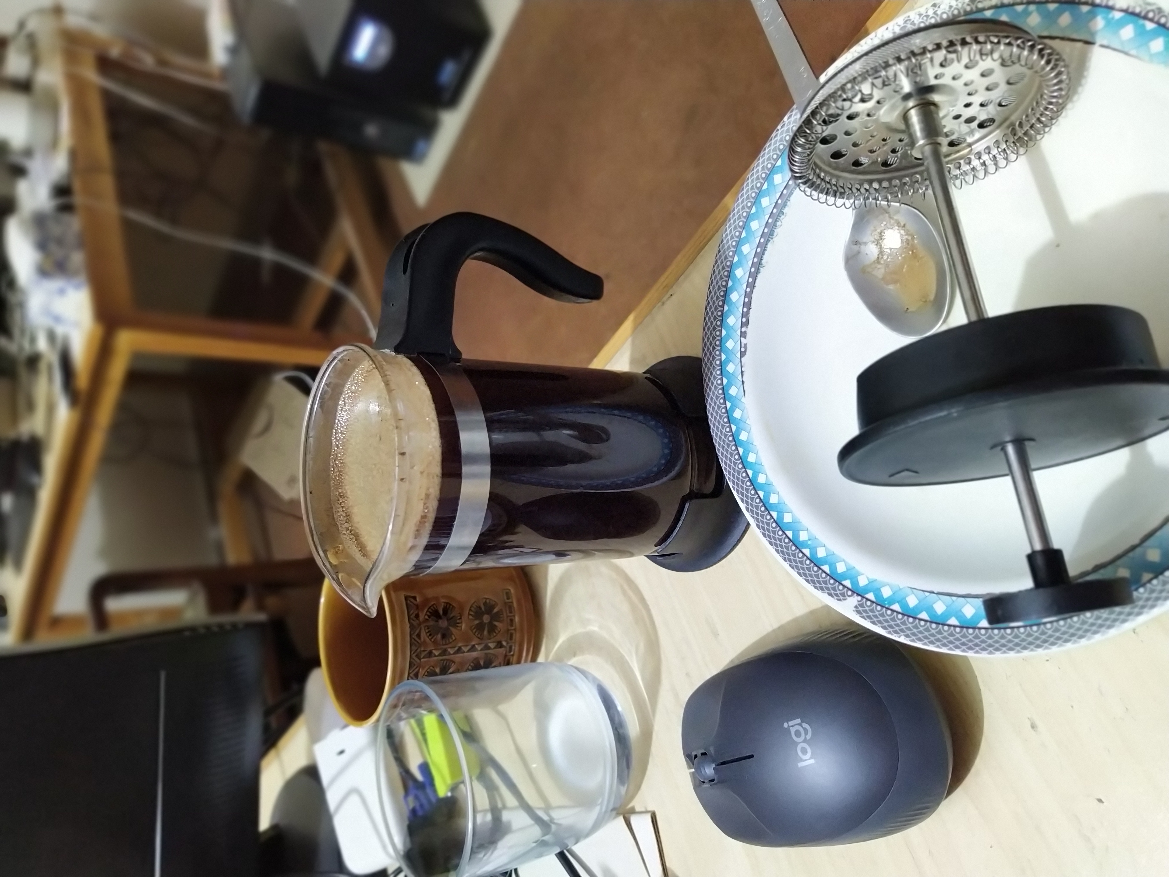 waiting for the coffee grounds in the french press to do their magic